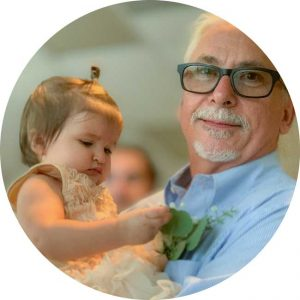 image of man holding a baby for testimonial blog post by client Jessica Banks Energy Yogini Reiki Master Psychic Healer