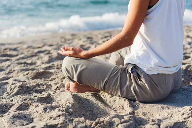 practicing mantra on beach-A mantra is often a set of deeply spiritual words that you repeat or chant over and over again. Usually short, and simple, all religions have a mantra