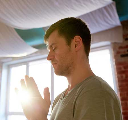 image of man with palms together in prayer position for Jessica Banks Yogini reiki master energy healer and psychic
