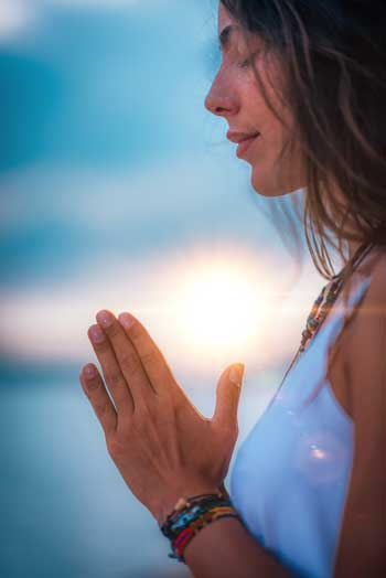 """image of woman with palms together in prayer for Jessica Banks, Energy Mender, Yogini, and Reiki Master """"Notice the connections and synchronistic events in your daily life"""""""